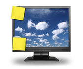 Adhesive notes on lcd with sky — Stock Photo