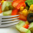 Greek salad and fork - Stock Photo