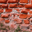 Old brick wall dating centuries back — Stock Photo