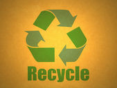 Recycling symbol on cardboard — Stock Photo
