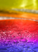 Multicolored background with water drops — Stock Photo