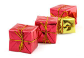 Red nad golden gifts — Stock Photo
