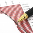 Stock Photo: Pen tip and business chart