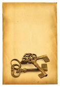 Keys on on paper — Stock Photo