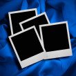 Royalty-Free Stock Photo: Photo frames against textile background