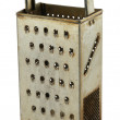 Old rusty grater on white — Stock Photo