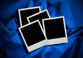 Photo frames against textile background — Stock Photo