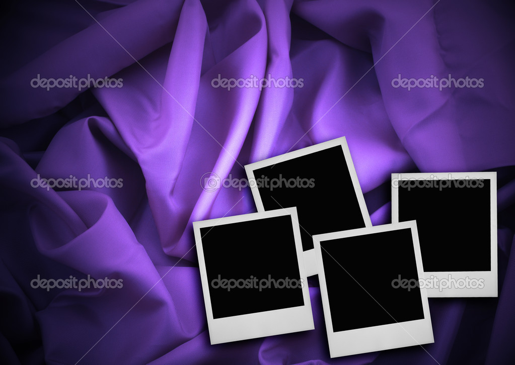 Four photo frames against purple textile background  Stock Photo #2320106