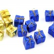 Golden and blue gifts isolated on white - Stock Photo