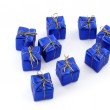 Group of blue gifts on white background — Stock Photo