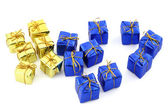 Golden and blue gifts isolated on white — Stock Photo