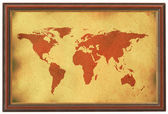 Old world map in wooden frame — Stock Photo