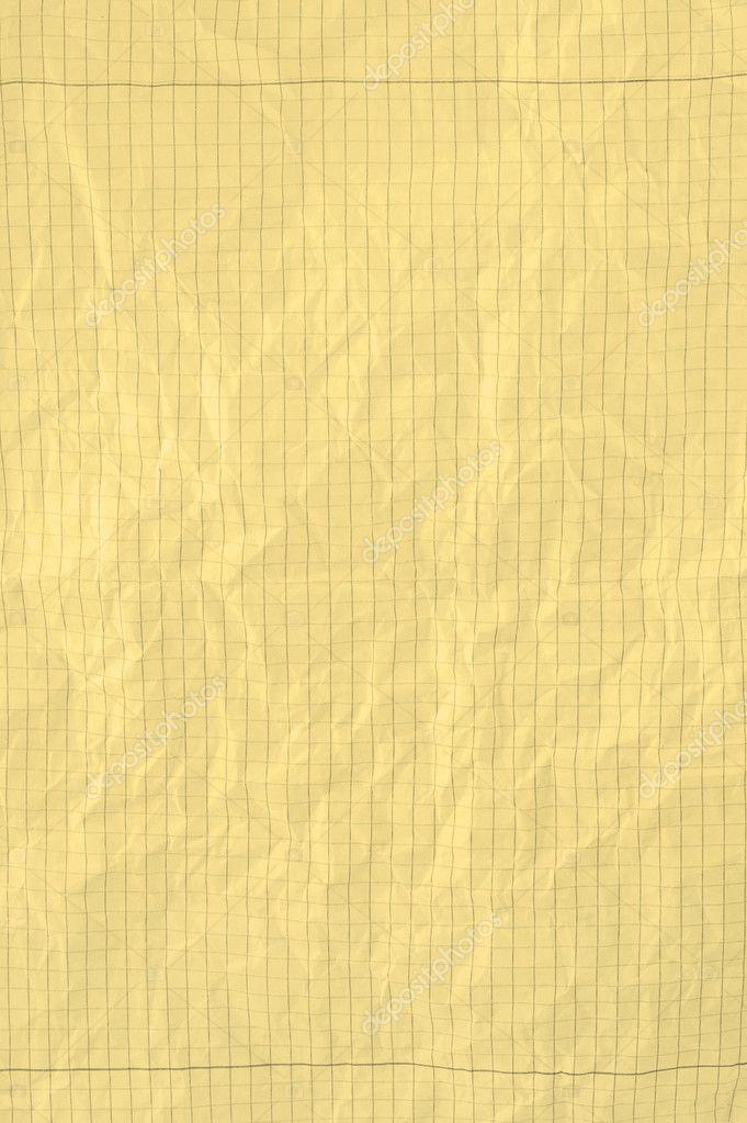 Yellow crumpled squared piece of paper — Stock Photo © yoka66 ...