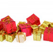 Various christmas gifts on white — Stock Photo