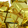 Stack of golden gifts — Stock Photo