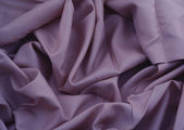 Close-up of creased purple satin — Stock Photo