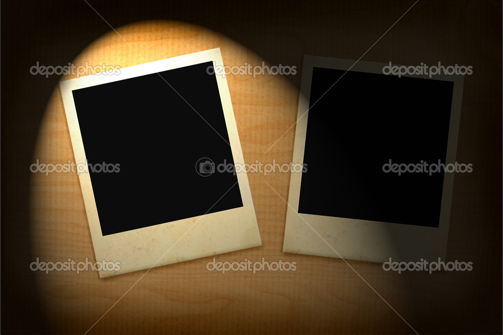 Two old photo frames lit in darkness — Stock Photo #2394226