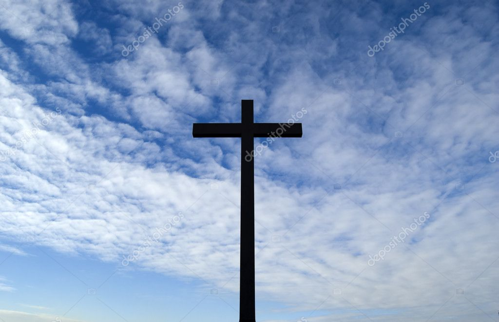 A cross in the blue sky  Stock Photo #2169116