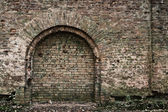 Old brick wall with arc — Stock Photo