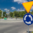 Stock Photo: Roundabout with clock and sign before