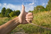 Thumb up for ecology and nature — Stock Photo