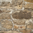 Stock Photo: Old sandstone wall