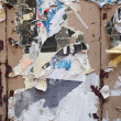 Stock Photo: Paper leftovers on old wooden wall