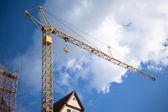 Yellow crane with blue sky — Stock Photo