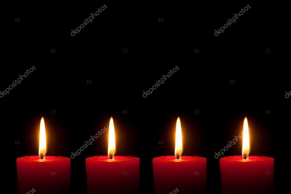 Four burning red candles in front of black background — Stock Photo #2214553