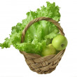 Green salad and apples in the basket — Stock Photo #2126009