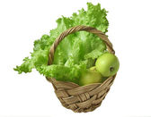 Green salad and apples in the basket — Stock Photo