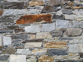 Wall of natural stones — Stock Photo