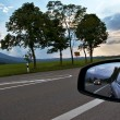 Sideview mirror road and car — Stock Photo
