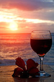Glass of wine on the beach — Stock Photo