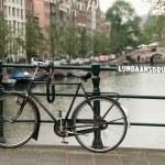 Bike parked on a bridge — Stock Photo #2600060