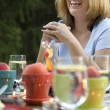 Woman laughing at dinner table — Stock Photo