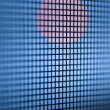 Red Circle Light in Blue Squares Grid — Stock Photo