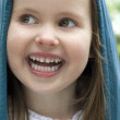 Stock Photo: Young Girl Grinning