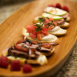 BruchettAppetizers on Wood Platter — Stock Photo #2193027