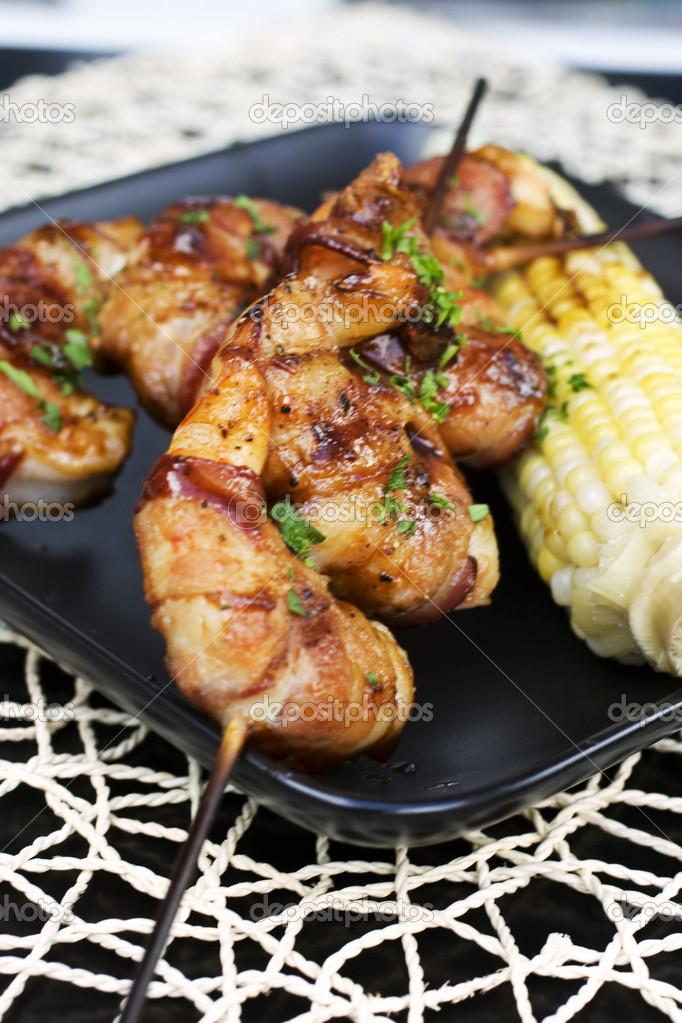 Skewers of bacon-wrapped shrimp at an outdoor dinner party.  — Stock Photo #2193016