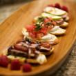 Bruchetta Appetizers on Wood Platter — Stock Photo #2292673