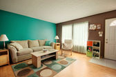 Teal and Brown Family Room — Photo
