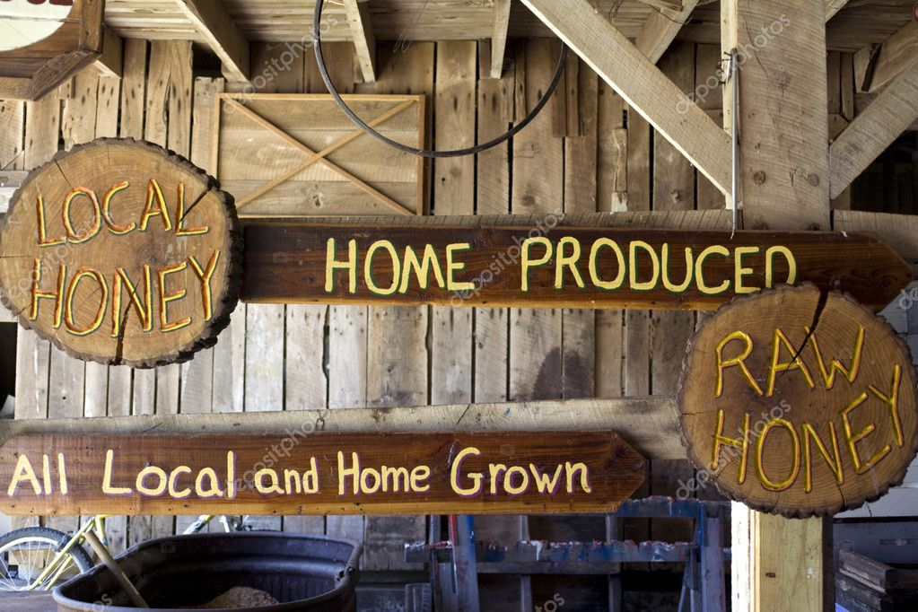 Honey signs hanging in old barn — Stock Photo #2293036