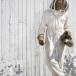 beekeeper with crossed legs — Stock Photo