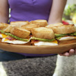 Royalty-Free Stock Photo: Woman Holding Platter of Egg Sandwiches