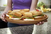 Woman Holding Platter of Egg Sandwiches — Stock Photo