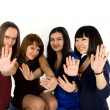 Royalty-Free Stock Photo: Happy four friends studio shot