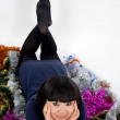 Stock Photo: Pretty girl lying among tinsel