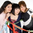 Three happy girls with ribbons — Stockfoto