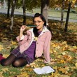 Funny college girl studying in autumn pa — Stock Photo